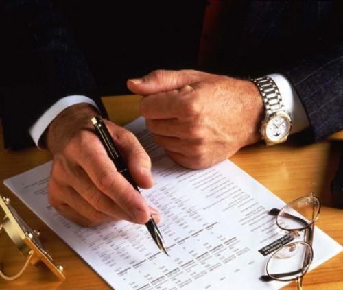 Lawyer reviewing an agreement of purchase and sale for a Toronto client.